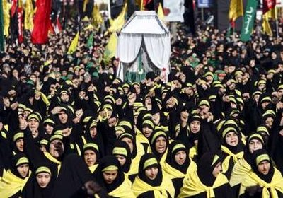 Female members of Lebanon's Hezbollah chant slogan during the Ashura ceremony held in Beirut's suburbs December 27, 2009