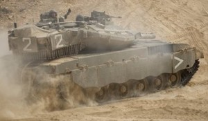 An Israeli tank maneuvers near the site of an exchange of fire between Israeli and Lebanese troops along the border between Israel and Lebanon, Tuesday, Aug. 3, 2010.