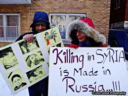 syrian poster- killings in syria is made in  Russia