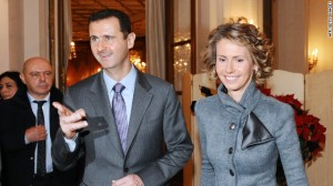Bashar al-Assad and his wife Asma at an exhibition in Paris in 2010