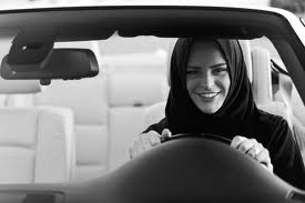 A Saudi woman  is driving a car in defiance of Saudi laws