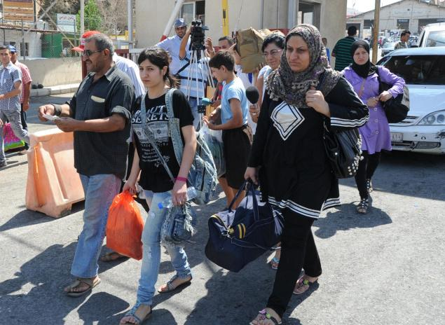 syrian refugees cross into Lebanon july 2012