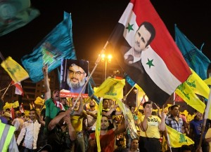 hezbollah supporters of assad wave flags
