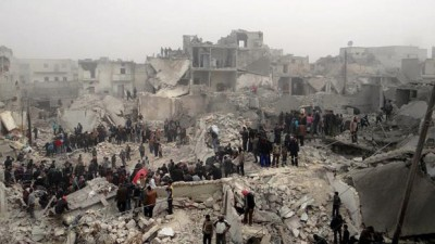 This citizen journalism image provided by Aleppo Media Center AMC, which has been authenticated based on its contents and other AP reporting, shows people searching through the debris of destroyed buildings in the aftermath of a strike by Syrian government forces, in the neighborhood of Jabal Bedro, Aleppo, Syria, Tuesday Feb. 19, 2013. /