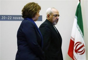 European Union foreign policy chief Ashton arrives with Iranian Foreign Minister Zarif during photo opportunity before start of three days of closed-door nuclear talks at United Nations European headquarters in Geneva