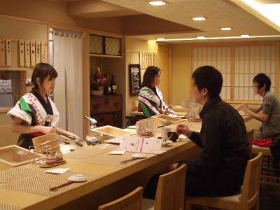 Women making  and serving Sushi at a Japanese Restaurant in Tokyo