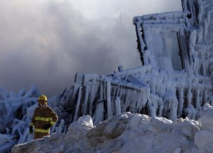 A firefighter looks on at the seniors residence Residence du Havre after a fire in L'Isle Verte