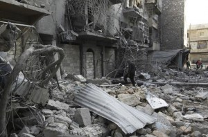 A man walks amid rubble of damaged buildings in the al-Myassar neighbourhood of Aleppo
